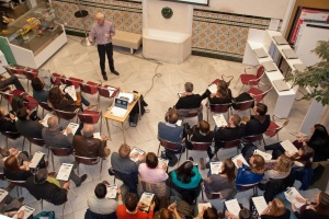 Addressing the audience in the patio of CLIC Seville